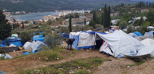 Migrants living in self-purchased tents in front of the overcrowded hotspot in Samos