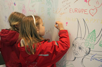 Children leaving a souvenir of their visit at the Commission
