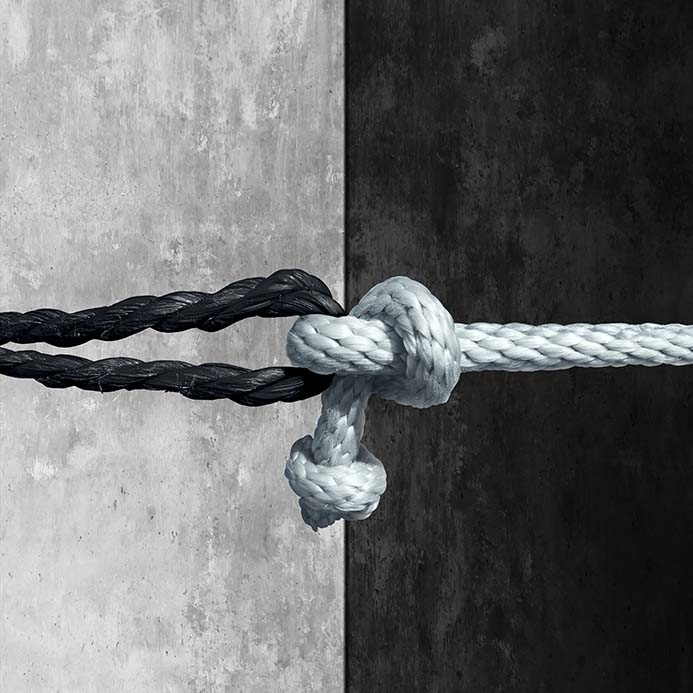 Two ropes black and white knotted together