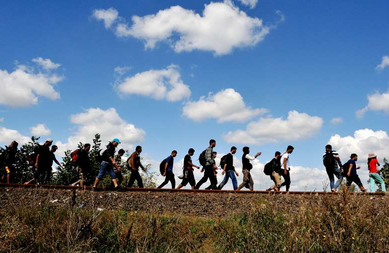 Refugees walking along an old railway line, just after crossing from Serbia into Hungary.©UNHCR/M.Henley