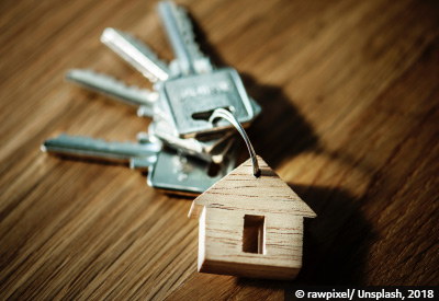 Wooden carving of a house on a key ring with keys