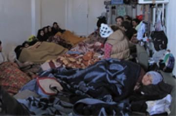 Situation in the detention centre: people crowding in a small room on the floor