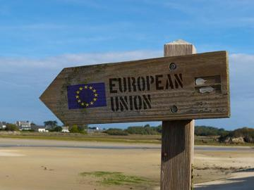 Sign pointing to the European Union