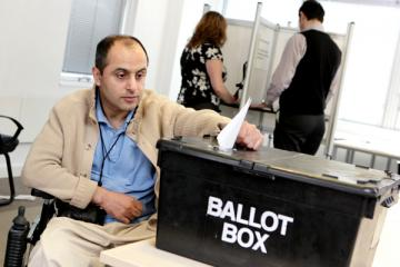 Man in a wheelchair casts his vote in the UK