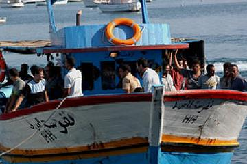 Migrants arriving on the island of Lampedusa in August 2007.