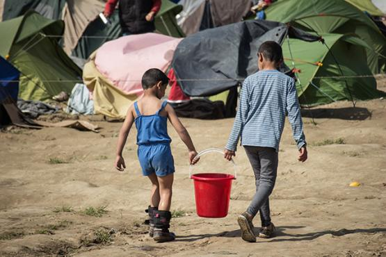 Two children in a refugee camp in Idomeni, Greece