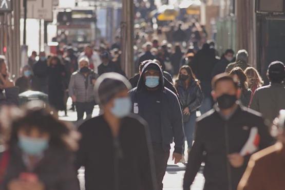 Crowd of people wearing masks