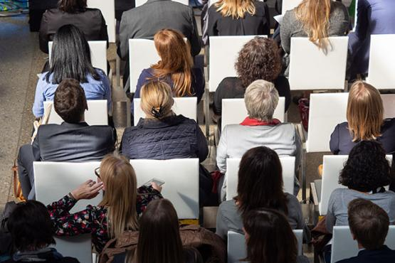 People sitting in rows on chairs