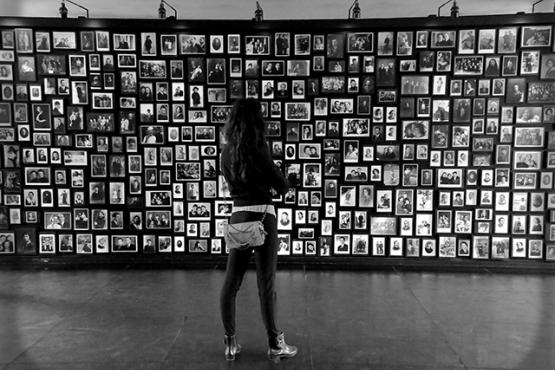 Young woman looks at a Holocaust memorial
